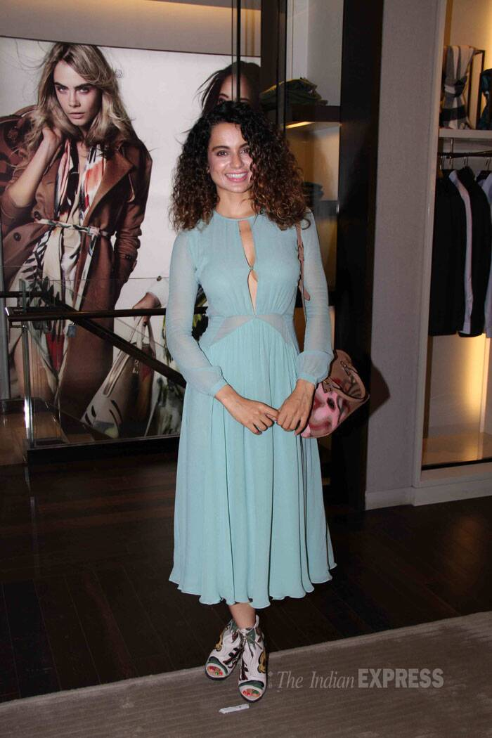 Kangana's hand painted bag and boots went well with the outfit. (Source: Varinder Chawla)