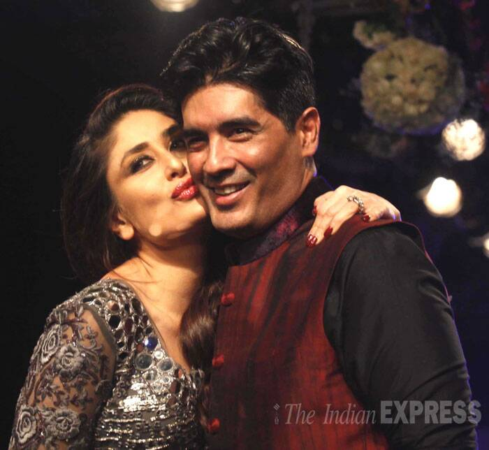 "Kareena hugs Manish Malhotra, the deisgner said: ""It's been a long journey. She is my sister. She has been the coolest bride I have ever dressed so Lakme can't have a better show stopper than Kareena."" (Source: Express Photo by Pradip Das)"