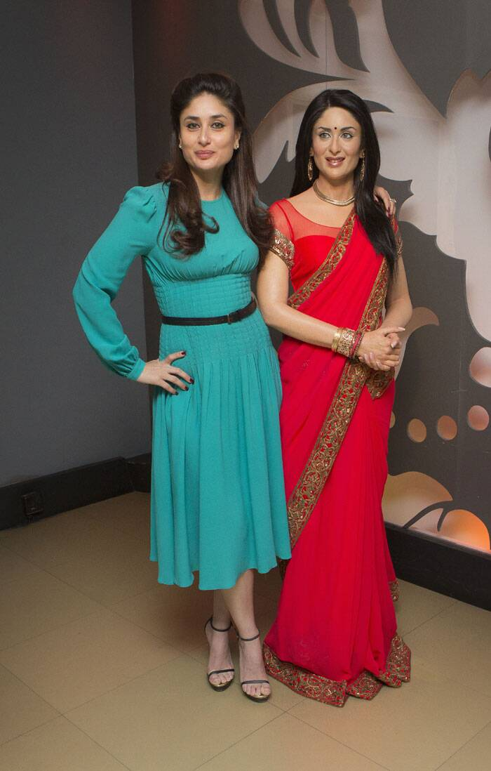 Kareena Kapoor Khan looked pretty in a teal coloured Michael Kors dress with black Saint Laurent sandals as she visited her wax double in London. A voluminous hairdo and nude coloured lips let her dress colour steal the show. (Source: AP)