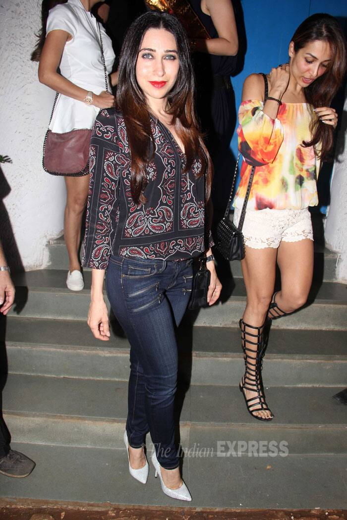 Karisma looked great in a printed top, skinny jeans and stilettos. (Source: Varinder Chawla)