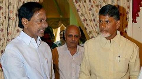 Telangana Chief Minister K. Chandrasekhara Rao and Andhra Pradesh Chief Minister N. Chandrababu Naidu before their joint meeting at Raj Bhavan in Hyderabad on Sunday. (Source: PTI)