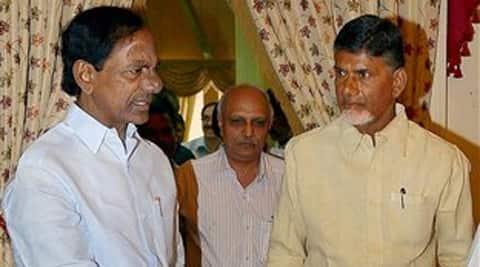 Telangana Chief Minister K. Chandrasekhara Rao and Andhra Pradesh Chief Minister N. Chandrababu Naidu before their joint meeting at Raj Bhavan in Hyderabad on Sunday. (Source: PTI)