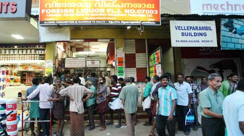 Long queue seen outside a liquor shop in Kaloor, Cochin.