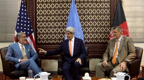 John Kerry, center, talks to Afghanistan's presidential candidate Abdullah Abdullah, left, as Jan Kubis, the U.N. Secretary-General's special representative. (Source: AP)