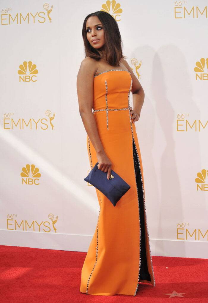 'Scandal' beauty Kerry Washington was chic in a tangerine coloured Prada dress. (Source: AP)