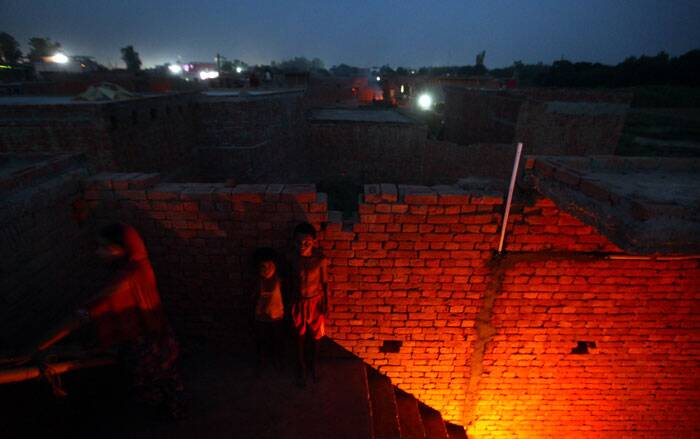 Kids at their newly constructed house in Aman Colony, Kandhla, Muzaffarnagar, UP. The colony has no electricity and manage with candles and LED torches. (Source: Express photo by Oinam Anand)