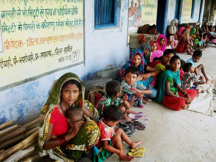 Villagers staying in a government school due to danger to Kosi's embankments after heavy flow of water into the river from Nepal's side in Supaul, Bihar on Sunday. (Source: PTI)