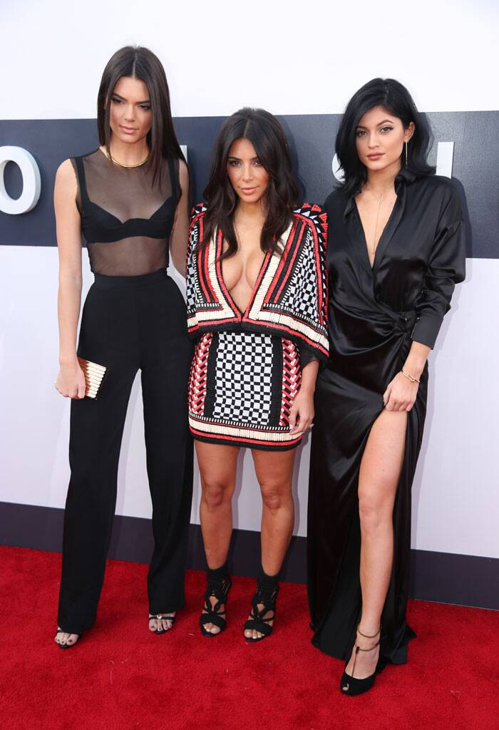 Kendall Jenner, from left, Kim Kardashian, and Kylie Jenner arrive at the MTV Video Music Awards at The Forum on Sunday. (Source:AP)