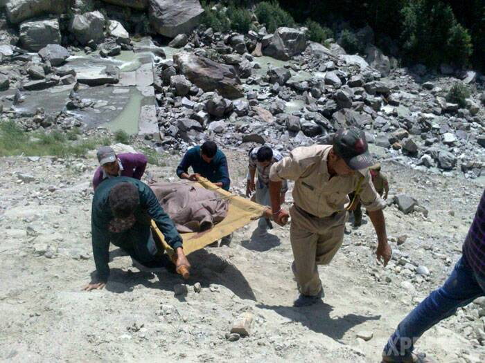 Locals and police are carrying out rescue operations. Police sources say that the toll is likely to increase. (Source: Express photo by  Abhimanyu Chakravorty)