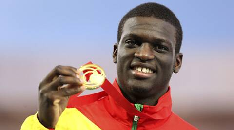 The 22 year old sprinter from Grenada with his gold medal. (Source: AP)