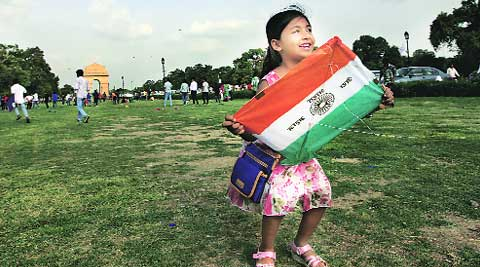 A girl with a tricolour kite at India Gate on Friday. (Source: Express photo by Ravi Kanojia)