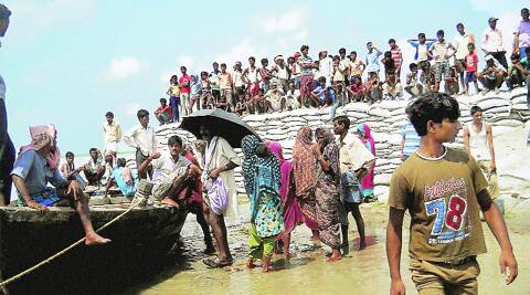 Flood-affected villagers wait to be rescued on the banks of the Kosi on Monday. Source: PTI