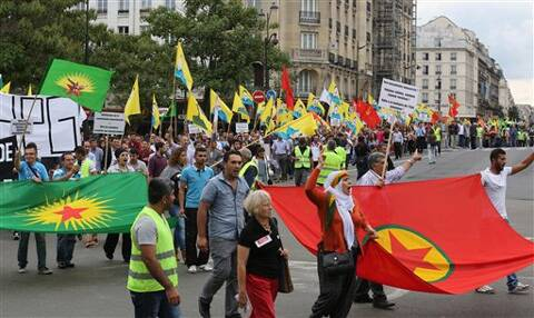 Kurdish demonstrators staged a protest in Paris, Saturday Aug. 9, 2014, in support of Kurds and Christians living in Iraq. Tens of thousands of Iraqi Christians and ethnic minorities are facing potential slaughter by Islamist militants in Iraq. Source: AP photo