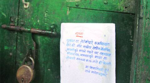 Notices have been pasted on the locked houses in Malin urging residents not to live in them as it could be dangerous.