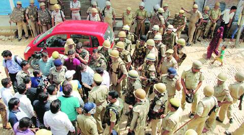 Police personnel in Loni, Ghaziabad, on Monday after a communal flare-up. (Source: Express photo by Gajendra Yadav)