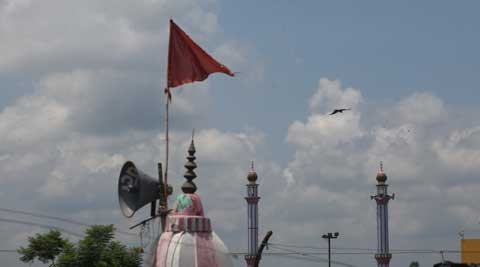 A temple and a mosque in Nehtaur, Bijnor, each with its own loudspeaker. There was a communal incident in the town on July 23. (Source: Express Photo by Oinam Anand)