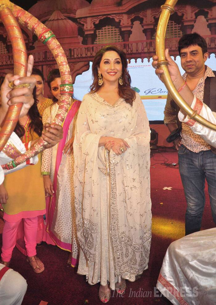 Actress Madhuri Dixit was also seen at the same dahi handi event in a beautiful cream and silver Indian outfit. (Source: Varinder Chawla)
