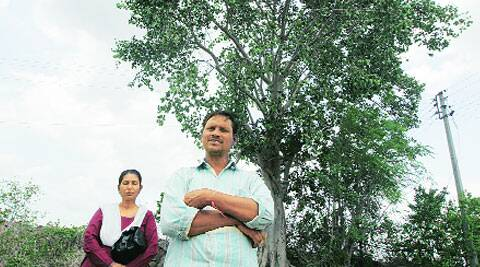 Prakas Shirsat by the tree under which he says villagers of Vanjoli planned to sacrifice his son Atul for a 'hidden treasure'. ( Source: Express photo bySandeep Daundkar )