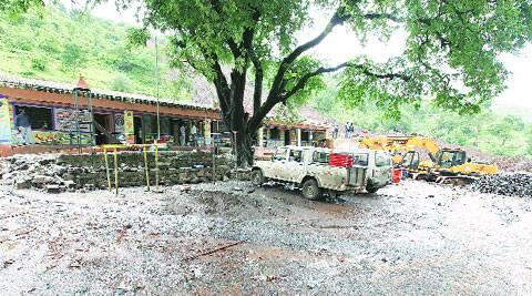 While the school remains, work on the road began on Thursday in the area surrounding it. (Express phto by Pavan Khengre)
