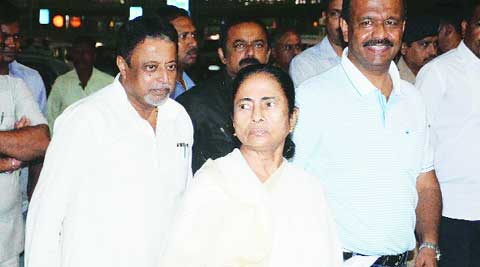 Chief Minister on her way to Singapore at Netaji Subhas Chandra Bose International airport on Sunday. Others in the picture are MP Mukul Roy (in back) and minister Firhad Hakim (left). (Source: Express photo)