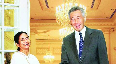 Chief Minister Mamata Banerjee greets Singapore Prime Minister Lee Hsien Loong during a meeting, in Singapore on Tuesday. (Source: PTI)