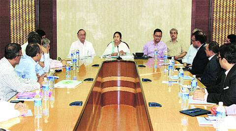 Chief Minister Mamata Banerjee and Finance Minister Amit Mitra during the review meeting with representative of different business houses, at Nabanna in Howrah, Wednesday. (Express Photo)