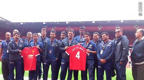 MS Dhoni and Gautam Gambhir shows the Man Utd jersey during their visit to Old Trafford on Sunday. (Source: BCCI)