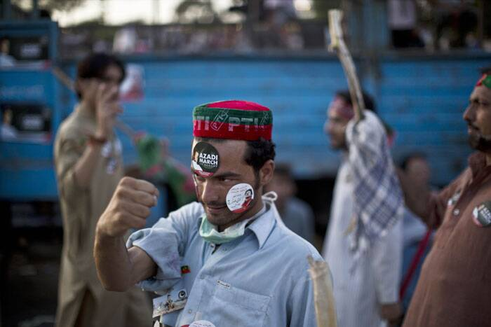 A supporter of Pakistani cricketer-turned-politician Imran Khan, gestures during a protest in Islamabad. (Source: AP)