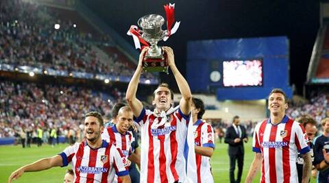 Atletico Madrid's Mario Mandzukic celebrates the cup victory bwith his team mates. (Source: Reuters)