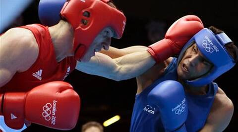 Manoj Kumar (R), the 2010 CWG gold medalist, was mistaken for his namesake (Source: AP)