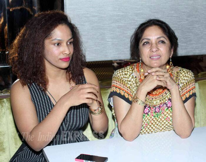 Designer Masaba was lovely in a monochrome outfit with bright pink lips as she took a seat with her actress mother Neena Gupta. (Source: Varinder Chawla)