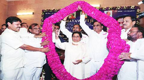 BSP chief Mayawati being welcomed by party senior leaders at a meeting held at the party head office in Lucknow on Saturday.  (Source: Express photo by Vishal Srivastav)