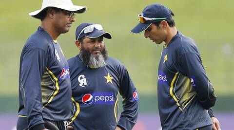 Pakistan's coaches Mushtaq Ahmed (C) and Waqar Younis (L) talk with team captain Misbah-ul-Haq during a practice session in Sri Lanka. (Source: Reuters)