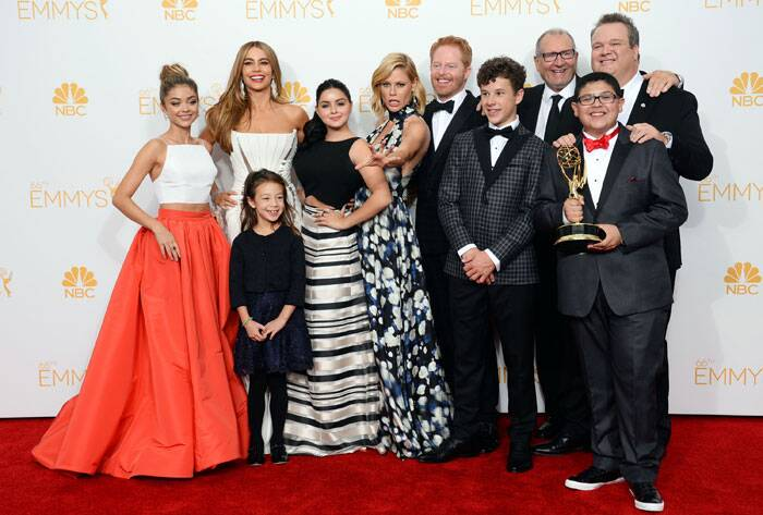 The cast of 'Modern Family' -  Sarah Hyland, from left, Sofia Vergara, Aubrey Anderson-Emmons, Ariel Winter, Julie Bowen, Jesse Tyler Ferguson, Nolan Gould, Ed O'Neill, Eric Stonestreet and Rico Rodriguez pose with wide smiles after winning the award for outstanding comedy series. (Source: AP)