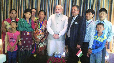 Narendra Modi with Jeet Bahadur (third from right) and his family members. Also seen on Modi's left is Binod Chaudhary, the Nepalese billionaire who traced Jeet's family.  (Source: Express photo)