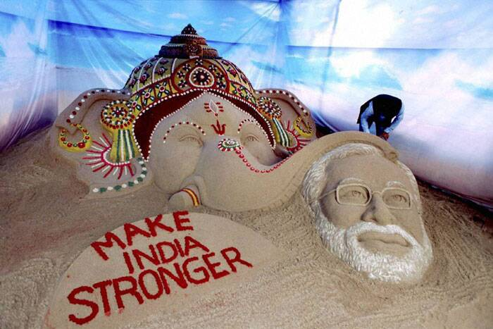 A sand sculpture created by sand artist Sudarsan Pattnaik depicting Lord Ganesh blessing Prime Minister Narendra Modi in Surat. (Source: PTI)