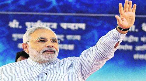 Modi waves at the crowd in Nagpur on Thursday.  (Source: PTI)
