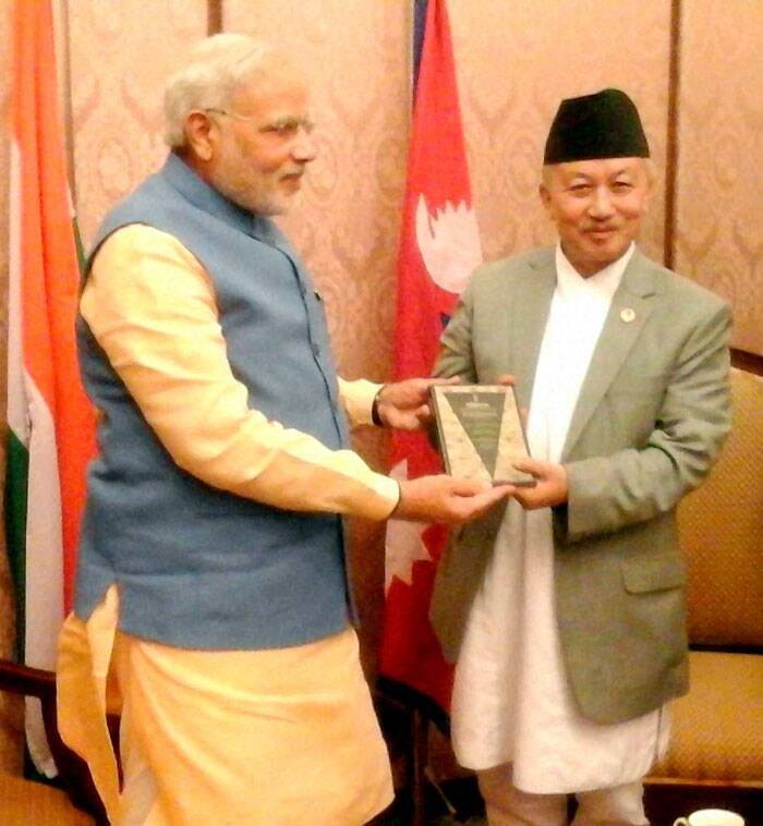 Prime Minister,  Narendra Modi gifts a book 'Samvidhaan' - Making of the Constitution of India to the Chair of the Constituent Assembly of Nepal, in Kathmandu, Nepal on Sunday. (Source: PTI)