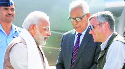 PM Narendra Modi, J&K Governor N N Vohra and CM Omar Abdullah in Leh on Tuesday. (Source: PTI)