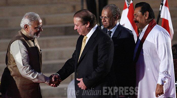 Prime Minister Narendra Modi is seen greeting Pakistan PM Nawaz Sharif while Sri Lankan President Rajapaksa and Mauritius PM Navin Ramgoolam look on during the oath taking ceremony of the BJP led government in New Delhi in May 2014. (Source: Express photo by Neeraj Priyadarshi)