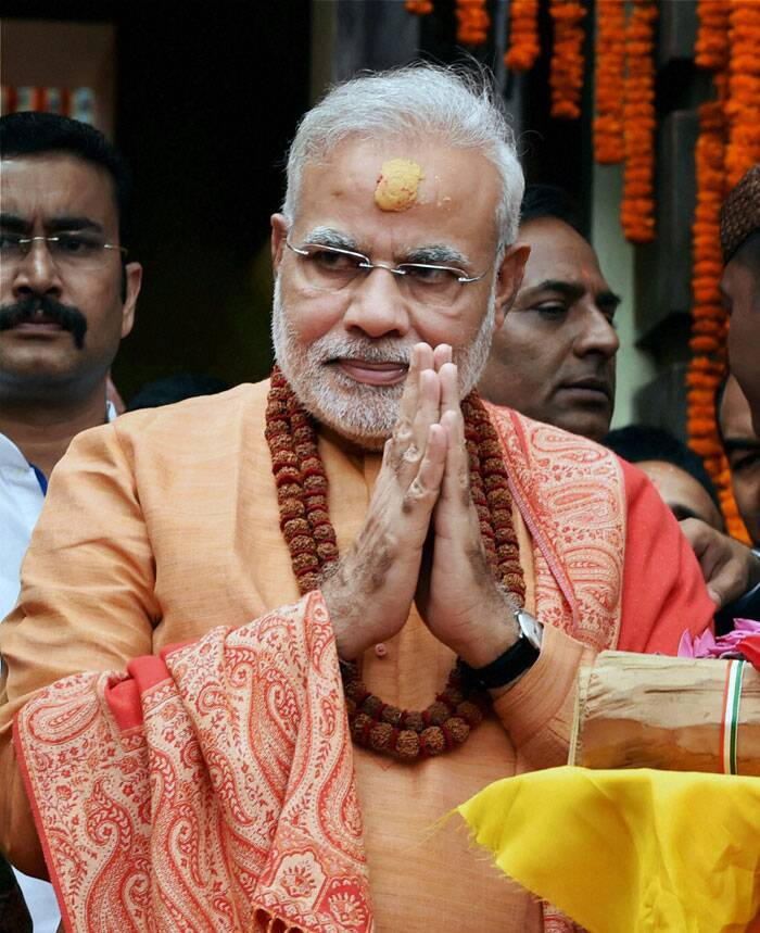 """Prime Minister Narendra Modi on Monday (August 4) offered special prayers at Nepal's famed centuries-old Pashupatinath Temple here and """"felt extremely blessed"""". A devout Hindu, 63-year-old Modi was at the temple of Lord Shiva for about 45 minutes on a 'Shravan ashtami' which is considered auspicious.<br /><br /> Prime Minister Narendra Modi gifts sandalwood to the Pashupatinath temple after praying at the temple in Kathmandhu, Nepal on Monday.  (Source: PTI)"""