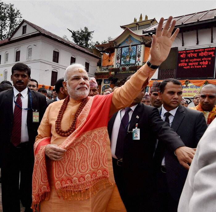 He donated 2500 kgs of sandalwood to the Pashupatinath Temple which is located on the banks of the Bagmati River in Deopatan, a village 3 km northwest of Kathmandu. <br /><br /> Narendra Modi waves to people as he comes out after praying at the Pashupatinath temple in Kathmandhu, Nepal on Monday.  (Source: PTI)