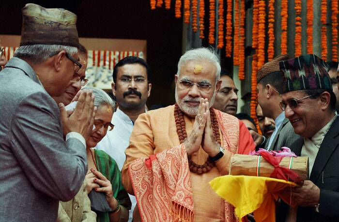 """""""Felt extremely blessed on offering prayers at Pashupatinath Temple this morning,"""" Modi tweeted after offering the puja at 5th century temple on the second and last day of his maiden trip to Nepal after assuming office in May. <br /><br /> Narendra Modi gifts sandalwood to the Pashupatinath temple after praying at the temple in Kathmandhu, Nepal on Monday.  (Source: PTI)"""