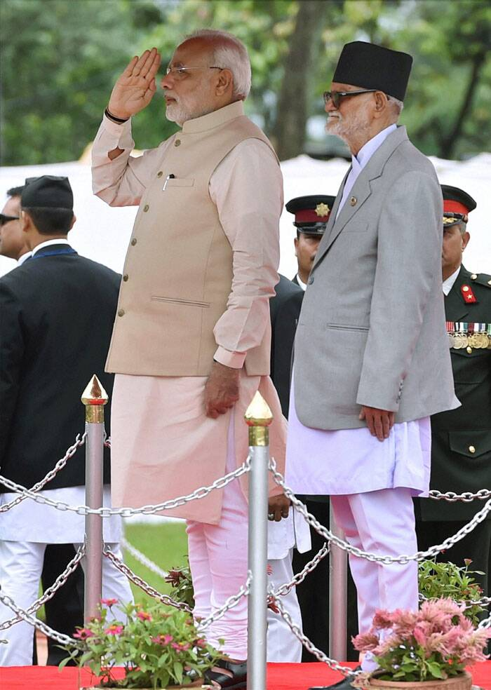 Prime Minister Narendra Modi during the official welcome ceremony seen with his Nepalese counterpart Sushil Koirala (R) on arrival at VVIP lounge compound of Tribhuvan International Airport in Kathmandu, Nepal on Sunday. (Source: PTI)
