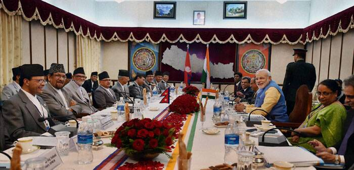 Prime Minister Narendra Modi and his Nepalese counterpart Prime Minister Sushil Koirala during a delegation level meeting at Chambers PMO, Singha Durbar in Kathmandu Nepal on Sunday. (Source: PTI)