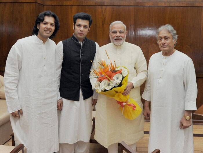 Prime Minister Narendra Modi with sarod maestro Amjad Ali Khan and his sons Amaan and Ayaan (extreme left) in New Delhi on Tuesday. (Source: PTI)