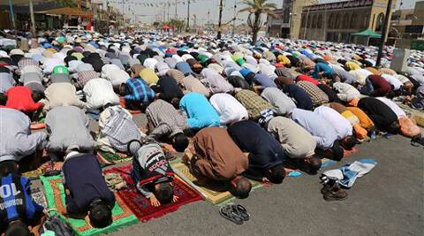 Followers of Shiite cleric Muqtada al-Sadr attend open-air Friday prayers in the Shiite stronghold of Sadr City, Baghdad, Iraq, Friday, Aug. 8 , 2014. (Source: AP)