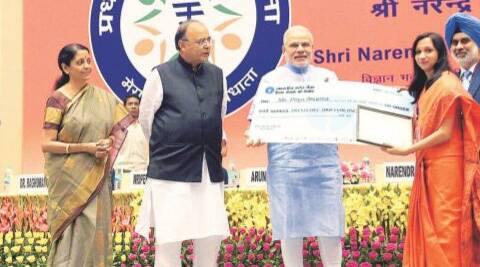 Prime Minister Narendra Modi felicitating Priya Sharma for her contribution in title and logo designing at the launch of the Pradhan Mantri Jan Dhan Yojana in New Delhi on Thursday. (PTI)