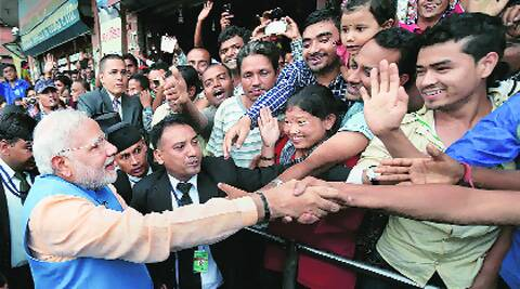 Modi meeting people lined up on Kathmandu roads after addressing Nepalese Parliament on Sunday. He made impromptu halts to interact with the crowd . Source: PTI