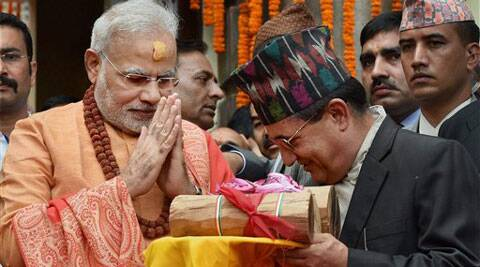 Prime Minister Narendra Modi gifts sandalwood to the Pashupatinath temple after praying at the temple in Kathmandhu, Nepal on Monday. (Source: PTI)